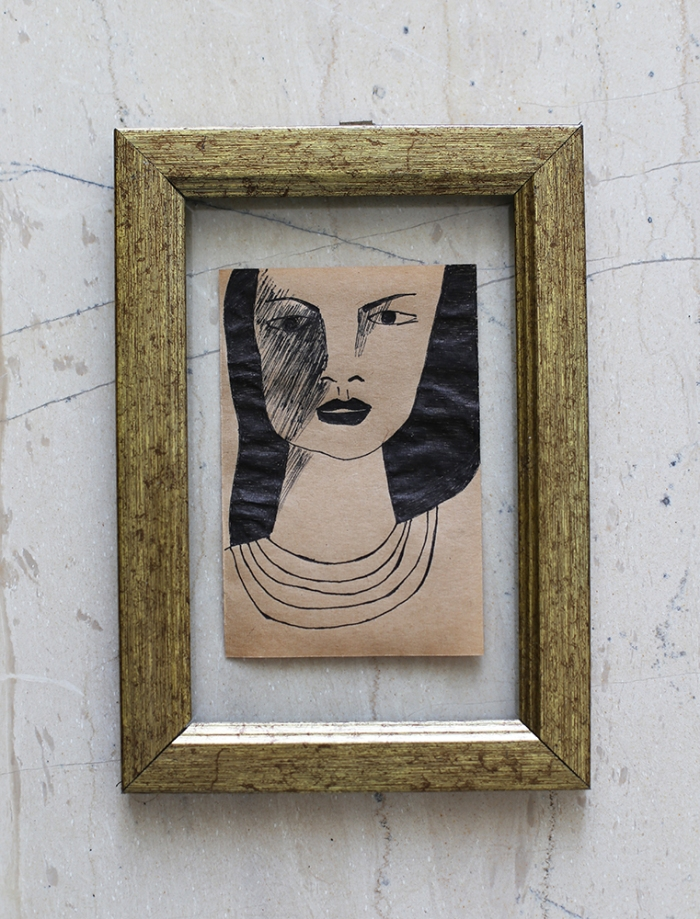 Feminine Portrait on Brown Recycled Paper